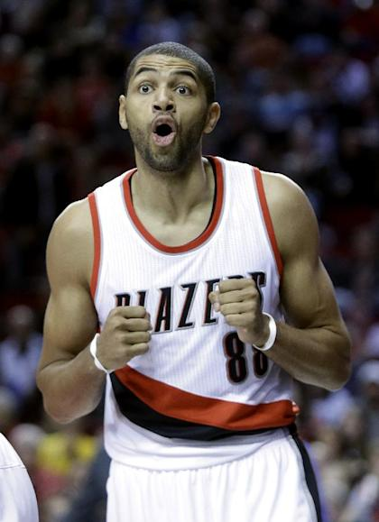 Portland Trail Blazers forward Nicolas Batum, from France, reacts after he is called for a foul during the first half of an NBA basketball game against the Golden State Warriors in Portland, Ore., Sunday, Nov. 2, 2014. (AP Photo/Don Ryan)