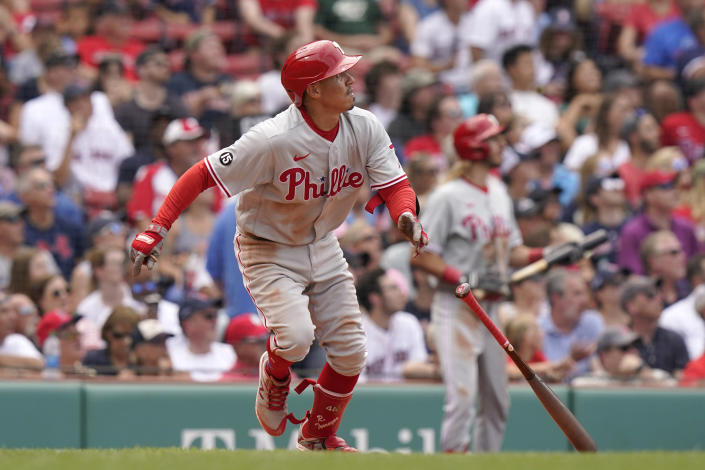 Philadelphia Phillies' Ronald Torreyes watches the flight of his three-run home run in the fourth inning of a baseball game against the Boston Red Sox, Sunday, July 11, 2021, in Boston. (AP Photo/Steven Senne)