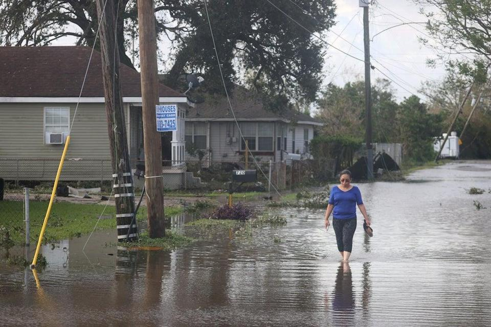 Angelina Coxum walks down a flooded street to check on a relatives home after Hurricane Ida passed through on August 30 (Getty Images)