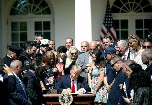 PHOTO: Surrounded by first responders and their families, President Donald Trump signs H.R. 1327, an act to permanently authorize the September 11th victim compensation fund, in the Rose Garden of the White House, July 29, 2019. (Win Mcnamee/Getty Images)