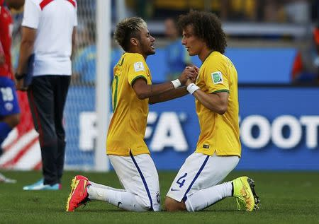 Brazil's Luiz and Neymar celebrate their win against Chile after their penalty shootout in their 2014 World Cup round of 16 game at the Mineirao stadium in Belo Horizonte