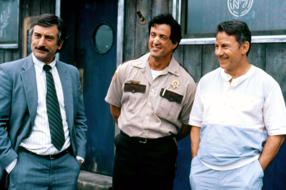 American actors Robert De Niro, Sylvester Stallone and Harvey Keitel on the set of Cop Land, written and directed by James Mangold. (Photo by Sunset Boulevard/Corbis via Getty Images)