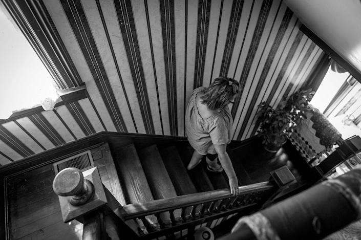 <p>Beth Genslinger mourns the death of her son Andy, who died from a heroin overdose in his bedroom in Germantown Ohio. He had been fighting his addiction for five years. (Photograph by Mary F. Calvert for Yahoo News) </p>