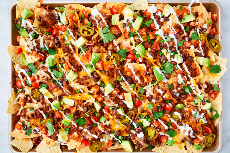 """<p>Is there anything more satisfying than a loaded tray of <a href=""""https://www.delish.com/uk/cooking/recipes/a30386864/instant-pot-nachos-recipe/"""" rel=""""nofollow noopener"""" target=""""_blank"""" data-ylk=""""slk:nachos"""" class=""""link rapid-noclick-resp"""">nachos</a>, still hot from the oven? They are the PERFECT weekend treat and they couldn't be any easier to make! This recipe is foolproof and sure to be delicious, but feel free to mix and match with your favourite ingredients. </p><p>Get the <a href=""""https://www.delish.com/uk/cooking/recipes/a28895357/nachos-supreme-recipe/"""" rel=""""nofollow noopener"""" target=""""_blank"""" data-ylk=""""slk:Nachos Supreme"""" class=""""link rapid-noclick-resp"""">Nachos Supreme</a> recipe.</p>"""