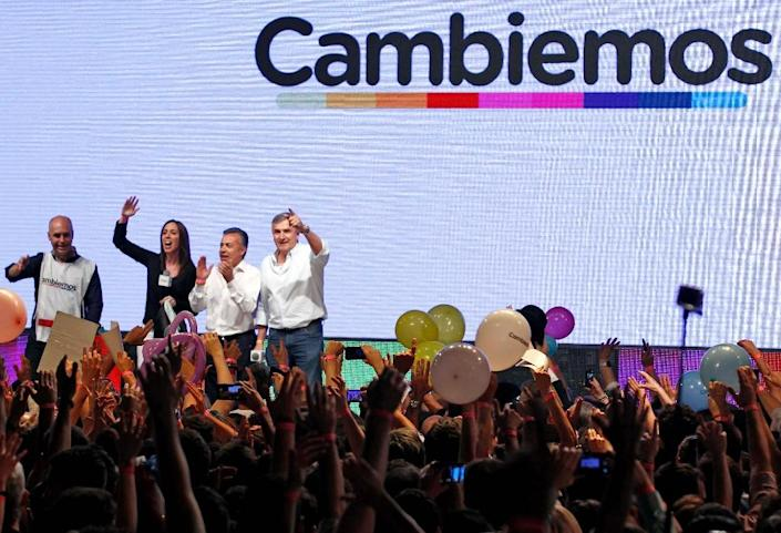 """Macri led a movement called """"Let's Change"""" vowing to roll back policies that Kirchner says help the working class but business leaders say wrecked economic growth (AFP Photo/Emiliano Lasalvia)"""