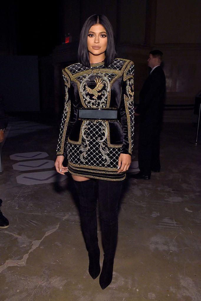<p>Jenner wore a mini dress and boots by Balmain to the BALMAIN X H&M Collection Launch.</p>