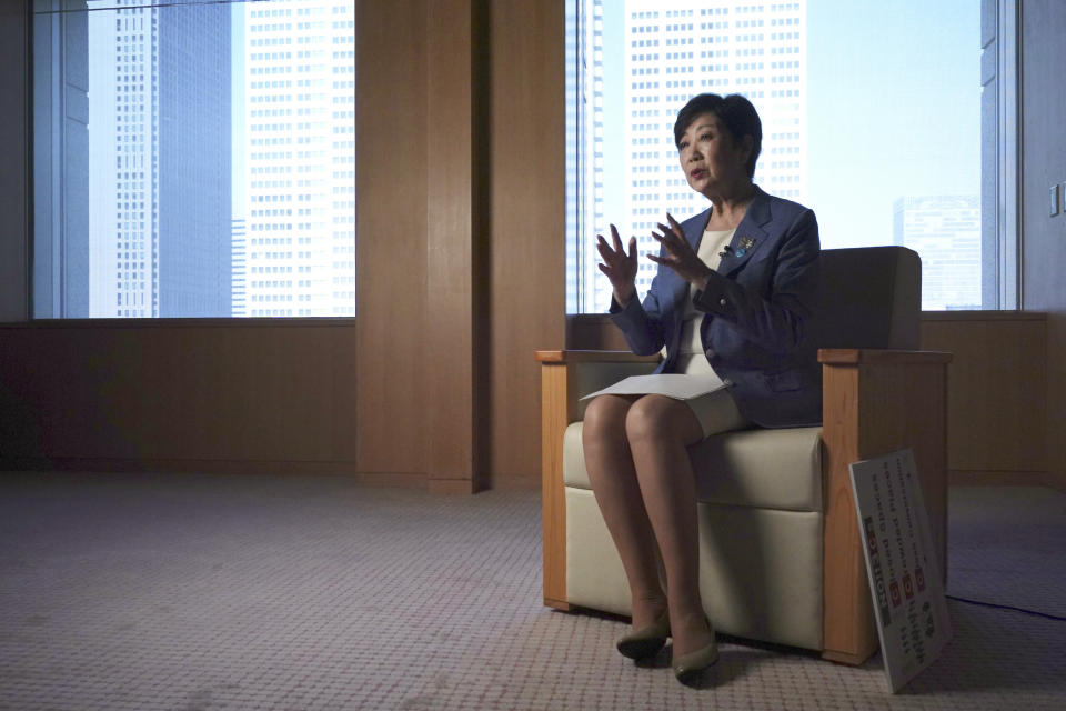 Tokyo Gov. Yuriko Koike speaks during an exclusive interview with The Associated Press at her office of the Tokyo Metropolitan Government Building in Tokyo Wednesday, June 17, 2020, ahead of a two-week campaigning for the election. A political go-getter, Koike even had the coronavirus crisis turn in her favor. And she repeatedly upstaged Prime Minister Shinzo Abe by taking more proactive steps ahead of him, gaining public support. Timing is also on her side now, she is cruising to a certain victory in the July 5 election for her second term as head of the Japanese capital. (AP Photo/Eugene Hoshiko)
