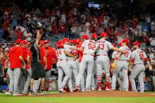 The St. Louis Cardinals celebrate their 13-1 win over the Atlanta Braves in game five of Major League Baseball's National League Division Series