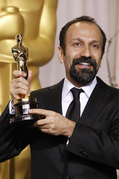 """FILE - In this Sunday, Feb. 26, 2012 file photo, Asghar Farhadi, of Iran, poses with the Oscar for best foreign language film for """"A Separation"""" during the 84th Academy Awards in the Hollywood section of Los Angeles. Iranian authorities canceled a ceremony Monday in honor of the country's Oscar-winning director even though the government had hailed his win as a triumph over a competitor from Israel. The event for Asghar Farhadi, whose movie, """"A Separation,"""" won the Oscar for best foreign film last month, was abruptly scrapped after authorities denied permission, according to the semiofficial Ilna news agency.(AP Photo/Joel Ryan, File)"""