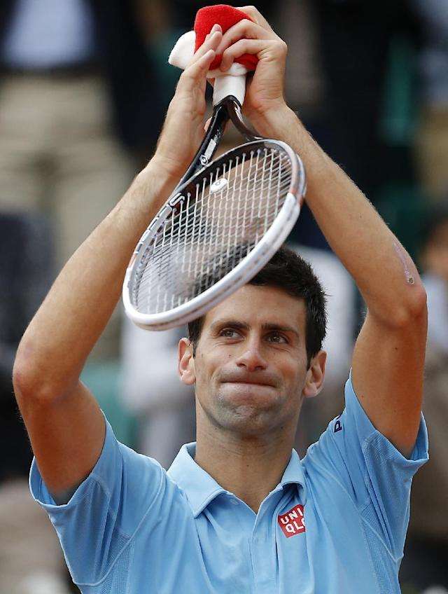 Serbia's Novak Djokovic waves after defeating Croatia's Marin Cilic during their third round match of the French Open tennis tournament at the Roland Garros stadium, in Paris, France, Friday, May 30, 2014. Djokovic won 6-3, 6-, 6-7, 6-4. (AP Photo/Michel Spingler)