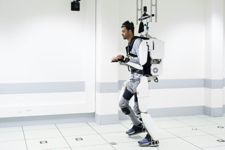 French tetraplegic 'Thibault' trained for months, harnessing his brain signals to control a computer-simulated avatar to perform basic movements before using the robot device to walk (AFP Photo/HO)