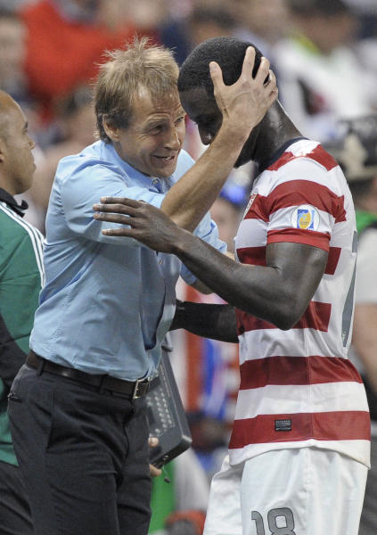 U.S. manager Jurgen Klinsmann hugs forward Eddie Johnson as Johnson leaves the game late in the second half of a World Cup qualifying soccer match against Guatemala in Kansas City, Kan., Tuesday, Oct. 16, 2012. The United States won 3-1. (AP Photo/Reed Hoffmann)