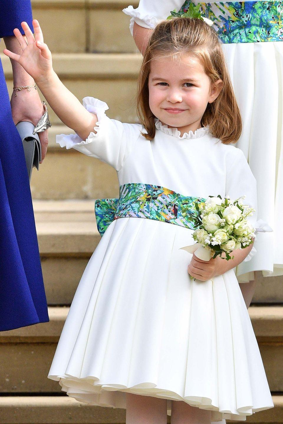 <p>Princess Charlotte steals the show as she waves to crowds gathered outside of St. George's Chapel. </p>