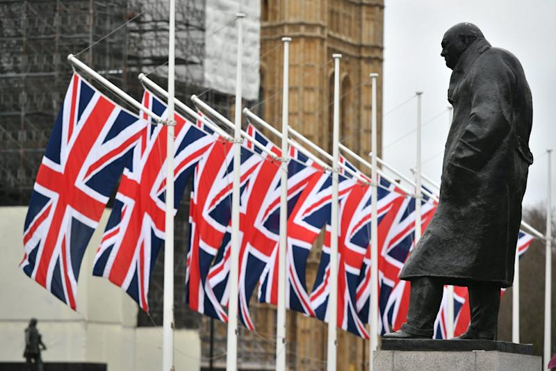 The Winston Churchill statue and Union flags in Parliament Square (PA)