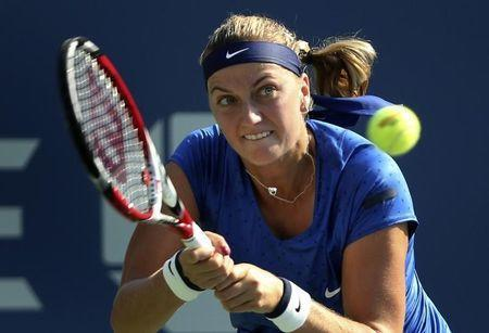 Petra Kvitova of the Czech Republic hits a return to Kristina Mladenovic of France during their match at the 2014 U.S. Open tennis tournament in New York, August 26, 2014. REUTERS/Adam Hunger