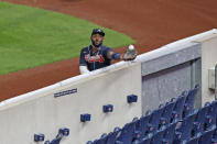 Atlanta Braves right fielder Marcell Ozuna tries to catch a foul fly ball but comes up short as it bounces in the empty stands during the fifth inning of a baseball game against the New York Yankees, Tuesday, Aug. 11, 2020, in New York. (AP Photo/Kathy Willens)