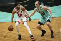 Chicago Bulls forward Otto Porter Jr. (22) is guarded by Charlotte Hornets center Cody Zeller (40) during the second half of an NBA basketball game in Charlotte, N.C., Friday, Jan. 22, 2021. (AP Photo/Jacob Kupferman)