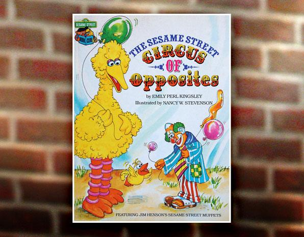 """According to one source, Elmo may have appeared in the 1981 book, """"<a href=""""http://www.worldcat.org/title/sesame-street-circus-of-opposites-featuring-jim-hensons-sesame-street-muppets/oclc/8493158"""" rel=""""nofollow"""">The Sesame Street Circus of Opposites</a>,"""" except he appeared as dark orange. Elmo though was a bit of an orphan. Three muppeteers couldn't connect to the furry red monster (who looked a bit shaggier back in those days). One day, young Kevin Clash was sitting in the Muppeteer-in-training greenroom when the late Richard Hunt (who voiced Scooter, Beaker, and Sweetums) <a href=""""http://www.time.com/time/arts/article/0,8599,1937077,00.html"""" rel=""""nofollow"""">tossed him Elmo and suggested he give it a try</a>. Clash and Elmo partnered up on November 18, 1985, and they've never looked back. (See an early Elmo <a href=""""http://www.youtube.com/watch?v=OvrhkWxDfcM"""" rel=""""nofollow"""">singing """"One Fine Face"""" with Ernie</a> in 1985.)"""
