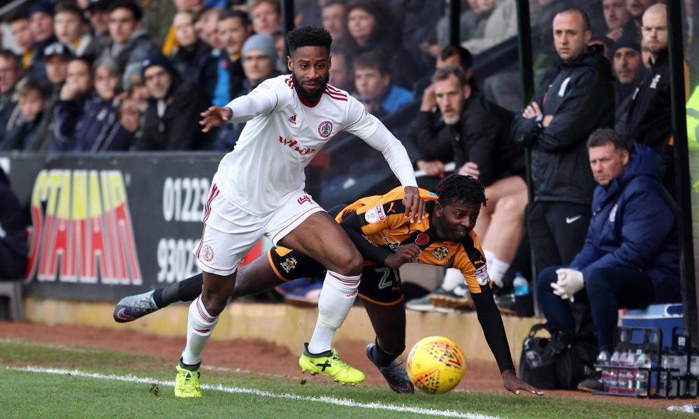 Janoi Donacien of Accrington gets the better of Medy Elito during the game.