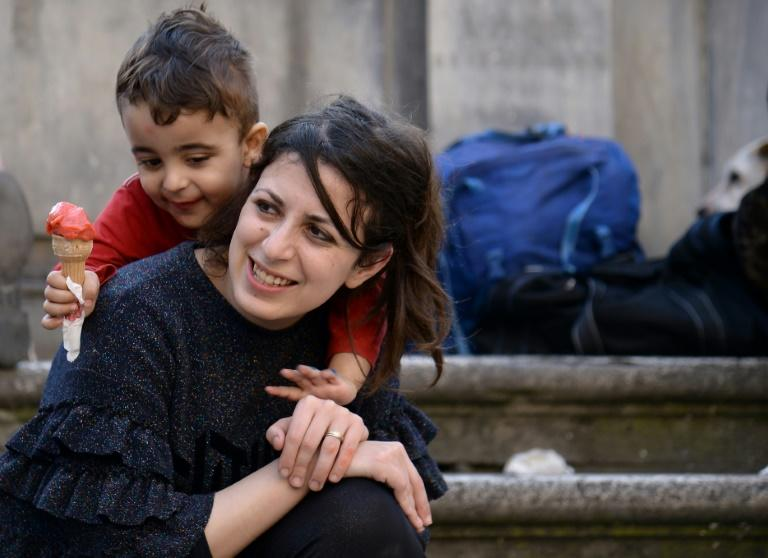 Syrians Nour and her son Riad are among the 12 refugees taken in by Pope Francis from a refugee camp a year ago