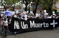 Demonstrators in Acarigua, Venezuela march on February 27, 2021 to demand justice for the victims of femicide