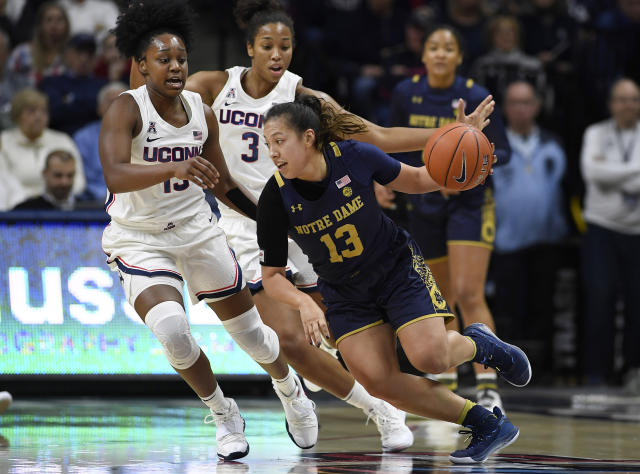 Notre Dame's Marta Sniezek (13), dribbles around Connecticut's Christyn Williams (13) and Connecticut's Megan Walker (3) in the first half of an NCAA college basketball game, Sunday, Dec. 8, 2019, in Storrs, Conn. (AP Photo/Jessica Hill)