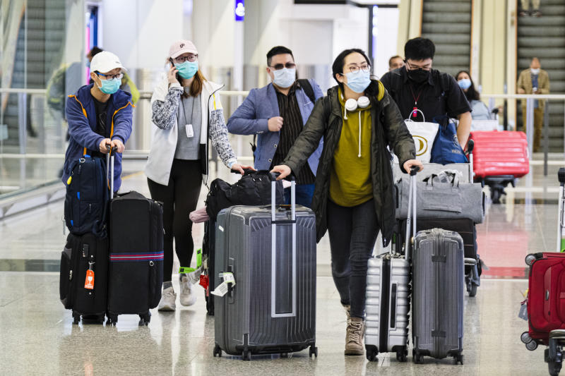 Passengers wear protective masks amid Coronavirus threats at the Hong Kong International Airport. In response to the latest situations of Covid-19 Pandemic, all people who have been to all overseas countries/territories in the past 14 days prior to arrival in Hong Kong, regardless of whether they are Hong Kong residents, are required by law for compulsory self-quarantine and to wear electronic bracelets, connected to an app to mark your location for two weeks. (Photo by Keith Tsuji / SOPA Images/Sipa USA)