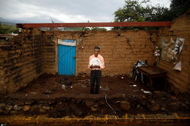 "<p>Prudencio Gutierrez, 66, a farm worker, poses for a portrait in front of his house after an earthquake in San Francisco Xochiteopan, Mexico, September 27, 2017. Gutierrez's house was badly damaged, but he was able to rescue his bed and some clothing. ""The most valuable thing that I recovered was my hat,"" he said. ""The authorities said they were going to help us build a house, but I do not know if it's true."" (Photo: Edgard Garrido/Reuters) </p>"