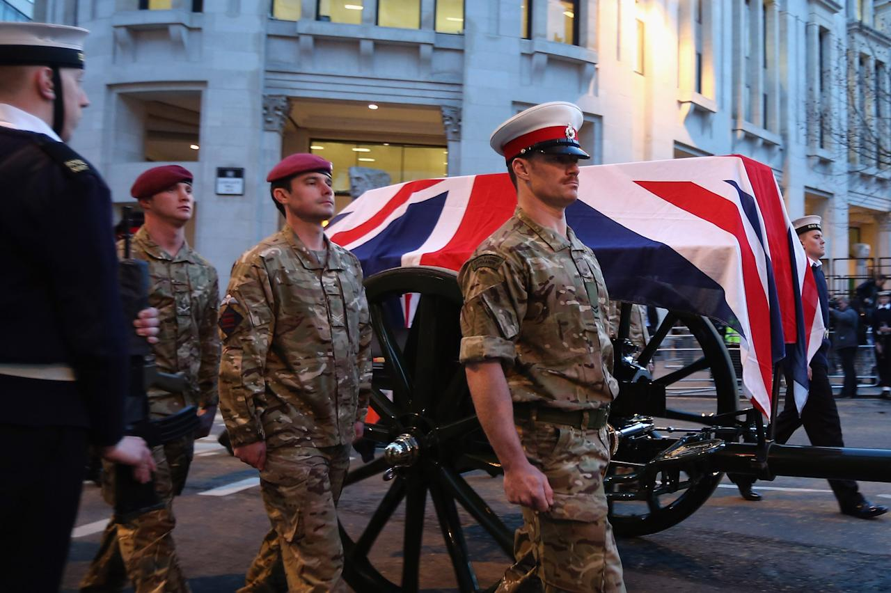 LONDON, ENGLAND - APRIL 15:  A flag draped coffin is carried on a gun carriage towards St Paul's Cathedral during a full military rehearsal for the ceremonial funeral procession for former British Prime Minister Margaret Thatcher in the early morning on April 15, 2013 in London, England. On Wednesday April 17, over 2,000 guests including global political figures and celebrities will attend the funeral of Margaret Thatcher at St Paul's Cathedral. The service will include 700 serving Armed Forces personnel, and will be led by the Band of the Royal Marines. The 87 year-old former prime minister died after suffering a stroke on April 8.  (Photo by Dan Kitwood/Getty Images)