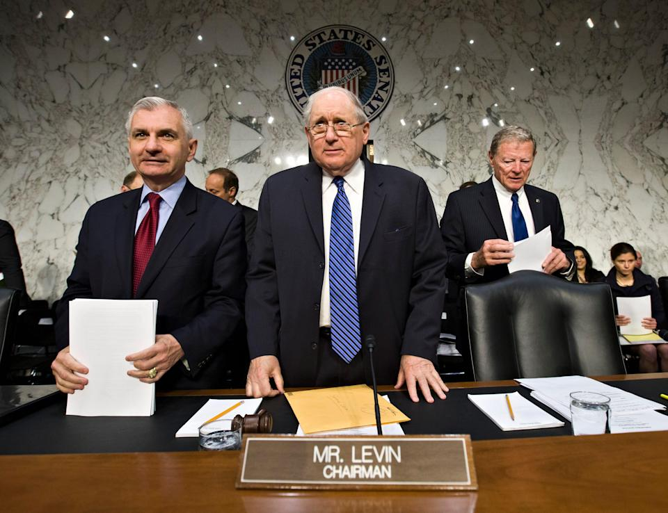 Senate Armed Services Committee Chairman Sen. Carl Levin, D-Mich., flanked by Sen. Jack Reed, D-R.I., left, and the committee's ranking Republican, Sen. James Inhofe, R-Okla., arrive on Capitol Hill in Washington on June 4, 2013, for the start of a hearing as Congress investigates the growing epidemic of sexual assaults within the military. Lawmakers are demanding answers from top uniformed leaders about whether a drastic overhaul of the military justice system is needed.