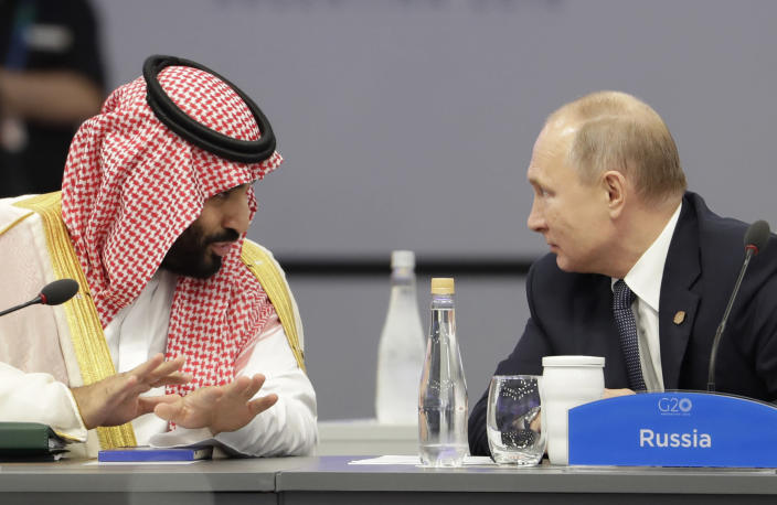 Saudi Arabia's Crown Prince Mohammed bin Salman, left, and Russia's President Vladimir Putin speak at the start of the G-20 summit in Buenos Aires, Argentina, Friday, Nov. 30, 2018. (Photo: Natacha Pisarenko/AP)