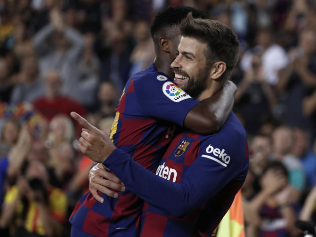 Barcelona's Gerard Pique, right, celebrates with teammates after scoring his side's third goal during the Spanish La Liga soccer match between FC Barcelona and Valencia CF at the Camp Nou stadium in Barcelona, Spain, Saturday, Sep. 14, 2019. (AP Photo/Joan Monfort)