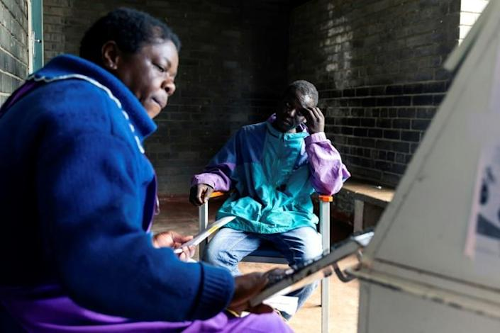 Blessing Chingwaru, an HIV positive and TB patient, has a consultation with a nurse at the Rutsanana clinic (AFP Photo/Jekesai NJIKIZANA)