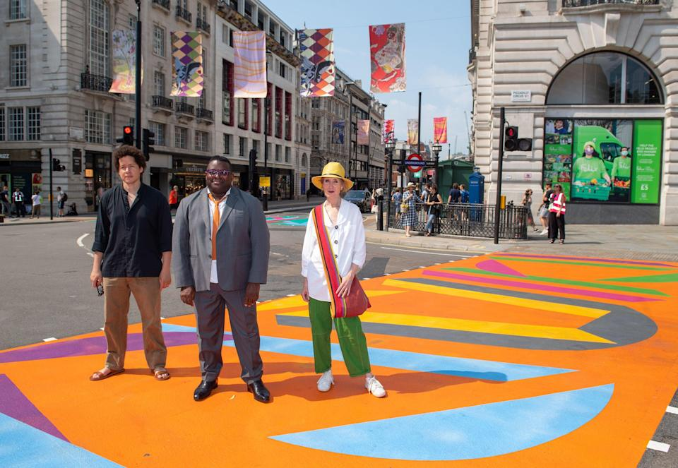 Artists (left to right) Michael Armitage, Vanessa Jackson and Issac Julian at Piccadilly Circus (PA)