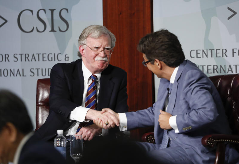Former National security adviser John Bolton, left, shakes hands with Dr. Victor D. Cha, right, Senior Adviser and Korea Chair, CSIS; Professor and Vice Dean, Georgetown at the Center for Strategic and International Studies (CSIS) in Washington, Monday, Sept. 30, 2019. (AP Photo/Pablo Martinez Monsivais)