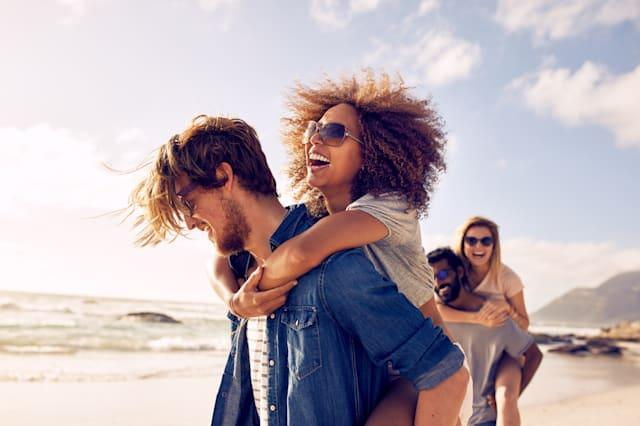 Young friends enjoying a day at beach.