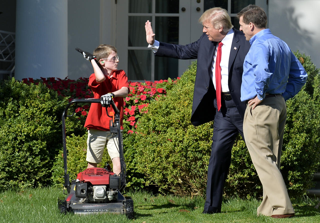 <p>President Donald Trump high fives Frank Giaccio, 11, of Falls Church, Virginia, as he mows the lawn in the Rose Garden of the White House on September 15, 2017, in Washington, DC.<br /> Giaccio, who has his own lawn mowing business wrote a letter to the President asking if he could mow the lawn at the White House. (Photo: Mike Theiler/AFP/Getty Images) </p>
