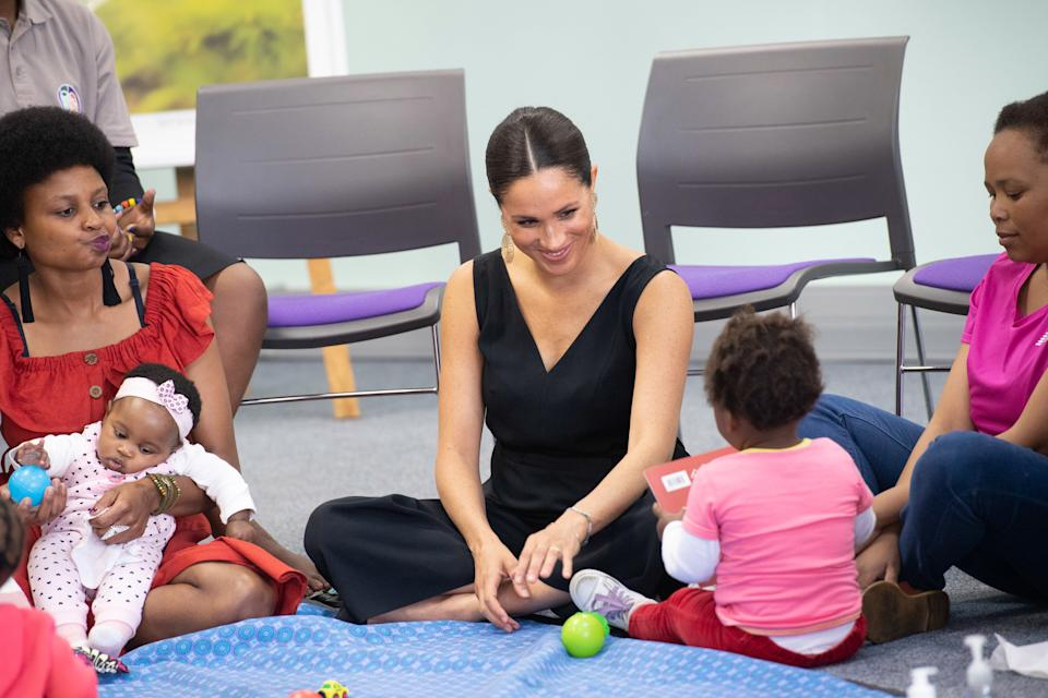 CAPE TOWN, SOUTH AFRICA - SEPTEMBER 25: (UK OUT FOR 28 DAYS) Meghan, Duchess of Sussex visits the African not-for-profit organisation 'mothers2mothers' during the royal tour of South Africa on September 25, 2019 in Cape Town, South Africa. The organisation trains and employs women living with HIV as frontline health workers across eight African nations. (Photo by Pool/Samir Hussein/WireImage)