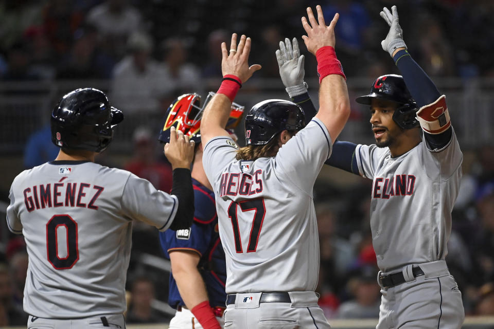 Cleveland Indians shortstop Andres Gimenez (0), catcher Austin Hedges (17) and left fielder Oscar Mercado (35) celebrate Mercado's three-run home run during the fifth inning of a baseball game against the Minnesota Twins, Wednesday, Sept. 15, 2021 in Minneapolis. (Aaron Lavinsky/Star Tribune via AP)