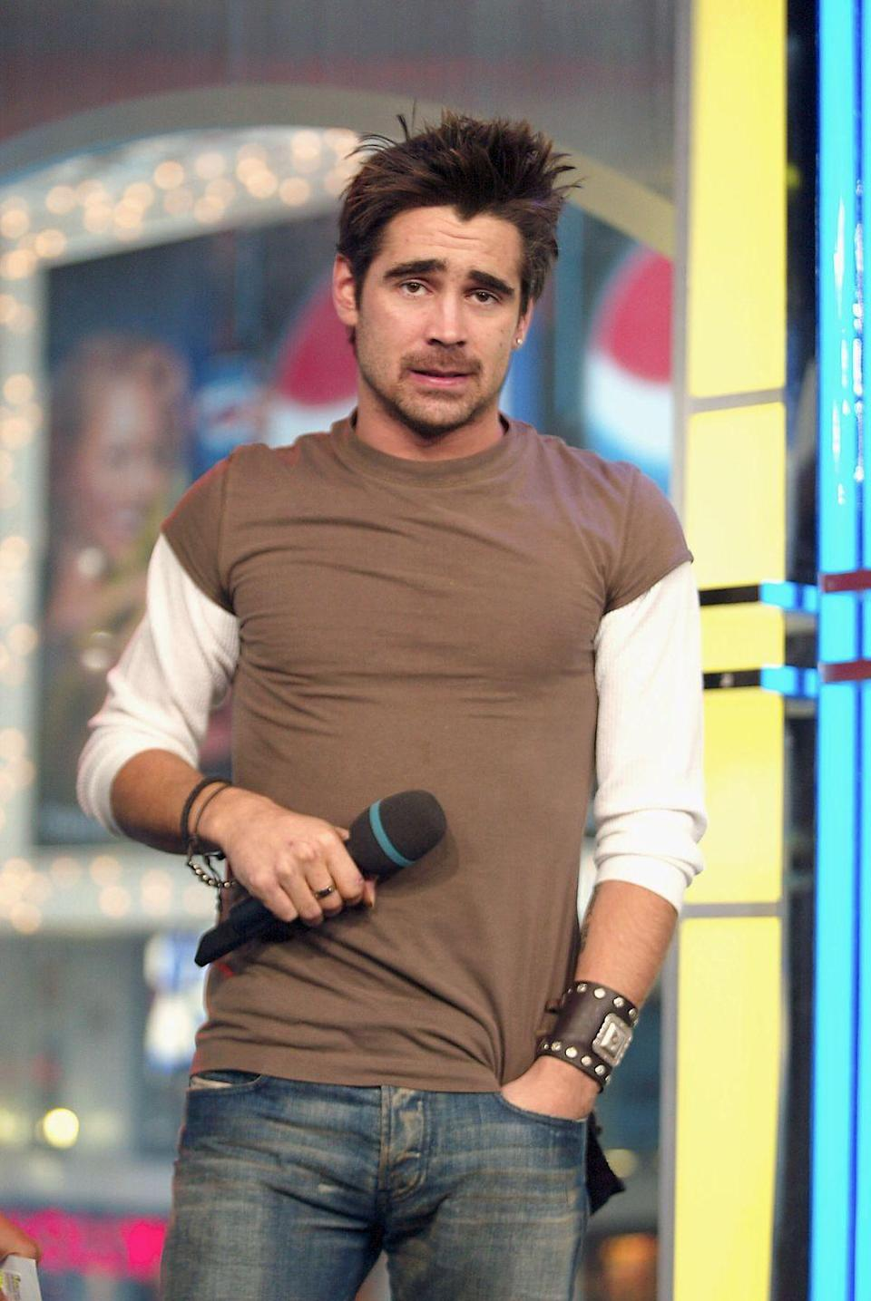 <p>Remember when all the cool dudes wore thick leather cuffs? So hot. Colin Farrell definitely earns bonus points on this outfit for the fitted layered t-shirt look. </p>