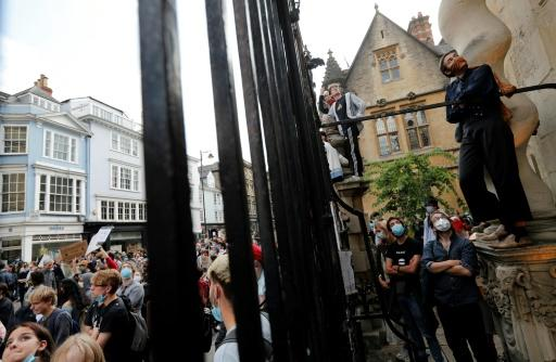 People demand the removal of a statue of British imperialist Cecil Rhodes outside Oxford's Oriel College