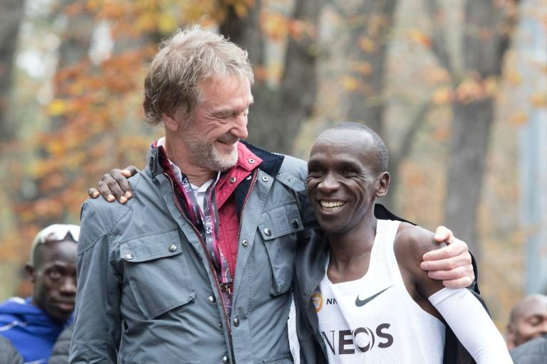 Eliud Kipchoge celebrates with Ineos owner Jim Ratcliffe after the Kenyan broke the two-hour marathon barrier in an event heavily sponsored by the petrochemicals company (AFP Photo/ALEX HALADA)