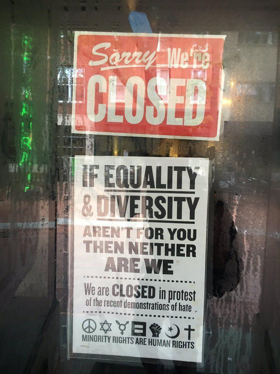 A sign on a business in downtown Charlottesville, Virginia.