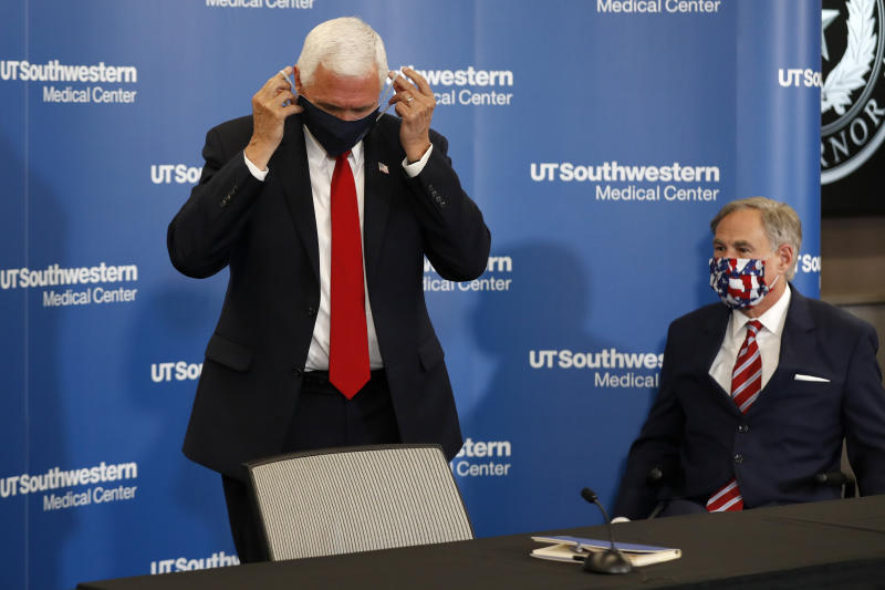 Vice President Mike Pence adjusts his mask as he and Texas Gov. Greg Abbott prepare to depart a news conference after Pence met with Abbott and members of his healthcare team regarding COVID-19 at the University of Texas Southwestern Medical Center West Campus in Dallas, Sunday, June 28, 2020. (Tony Gutierrez/AP Photo)