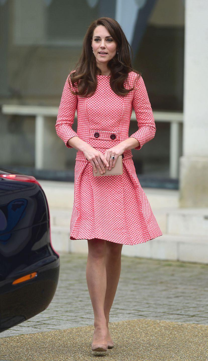 <p>In a pink tweed Eponine London jacket and skirt, and nude suede stilettos while out in London at an event for the Royal College of Obstetricians and Gynaecologists. </p>