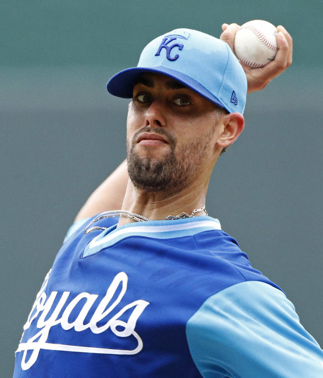 Kansas City Royals starting pitcher Jorge Lopez throws during the first inning of a baseball game against the Cleveland Indians Sunday, Aug. 26, 2018, in Kansas City, Mo. (AP Photo/Charlie Riedel)