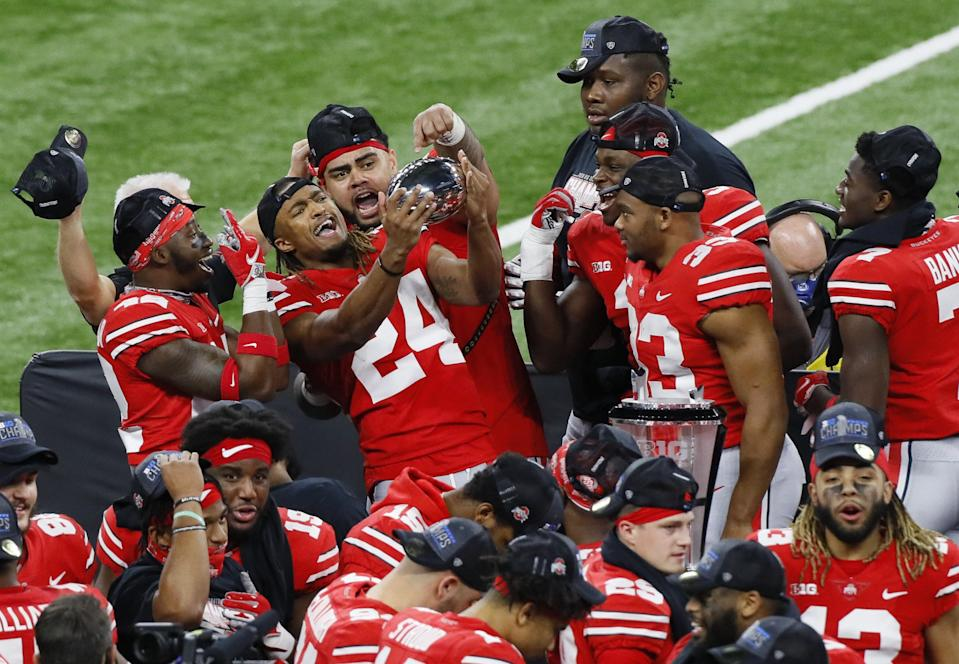 Ohio State Buckeyes cornerback Shaun Wade (24) celebrates with the Stagg Championship Trophy following their 22-10 win over Northwestern in the Big Ten Championship football game at Lucas Oil Stadium in Indianapolis on Saturday, Dec. 19, 2020.