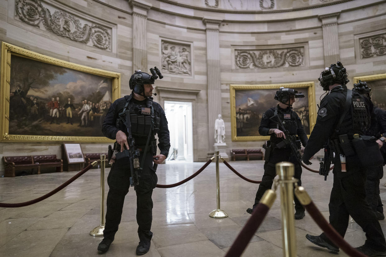 Members of the U.S. Secret Service Counter Assault Team walk through the Rotunda as they and other federal police forces responded as violent protesters loyal to President Donald Trump stormed the U.S. Capitol today, at the Capitol in Washington, Wednesday, Jan. 6, 2021. (AP Photo/J. Scott Applewhite)