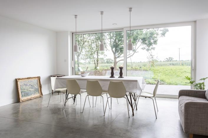 "<div class=""caption""> The dining area, situated in a space with a low ceiling, provides a more intimate experience. Plus, the stunning view to the land is a worthy way to dine. </div>"