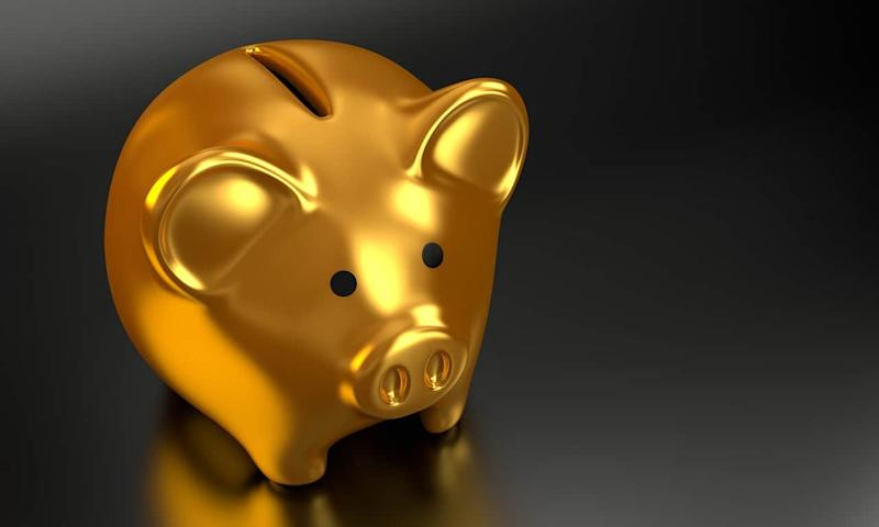 Golden piggy bank finance